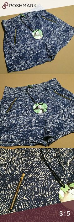 "Blue/white print silky shorts w/zippers. NWT Med. New, never worn. Mint Green brand. 100% polyester, silky feel, lightweight shorts. Elastic at back of waist. Two zippered pockets in the front. Size Medium. Waist measures approx. 28"" plus stretch. Tags attached. Mint Green Shorts"