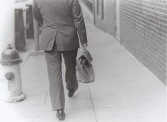 Photo by Victoria Zeller. Man with satchel; Pittsburgh, PA