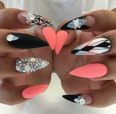 Matte black, coral stiletto nails with gems and designs