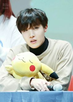 JHope // BTS The pikachu looks so happy to be in his arms