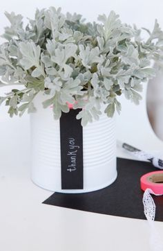 Recycle and gratitude at the same time! Spray a can white, use chalkboard paper, write a note of thanks and fill with flowers or a plant.  Easy and shows appreciation through minimal effort.  Win-win!