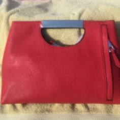 """Absolutely Stunning  The Limited Clutch """"RED"""" New with tags The Limited Red Clutch!! So cute!! Smooth Faux Leather..Front Zip Pocket.. Metal Cutout Handle.. Faux Leather trimmed inner zip pocket and pouch pocket 14""""Wx10""""Hx2 1/2""""D The Limited Bags Clutches & Wristlets"""