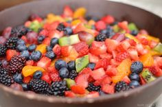 So, in order to have enough fruit salad for a Potluck, or a big crowd, I used: 4 lbs strawberries, washed and chopped 4 kiwi's, skinned, and chopped 1 pint blueberries, washed 1 pint blackberries, washed 1 cup red grapes 2 cans mandarin oranges, drained