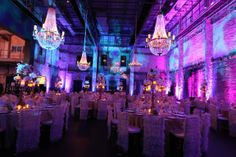 Corporate Party at Aria - grungy, eclectic purple decor for social hour with beautiful tables in gold hues for dinner