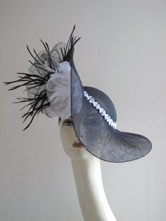 Ascot hat in black sinamay with white feather flower
