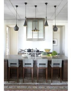 rug + pendant detail in contemporary wood and white kitchen design