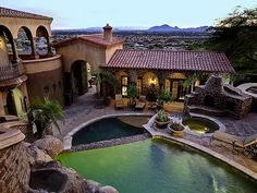 Hillside Spanish style home - Waterfalls from under the home pour into the pool, which steps down the slope in the entry courtyard...