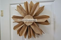 SimpleJoys: Paper Bag Flower Use the folded stitched brown paper packing strips, then cut and fold etc, for a sunburst? Crafts To Do, Easy Crafts, Crafts For Kids, Arts And Crafts, Creative Crafts, Paper Bag Flowers, Felt Flowers, Diy Paper, Paper Crafts