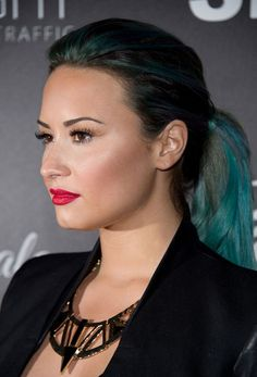 Demi Lovato works blue hair and red lips at the Red Light Traffic Dignity Gala in LA. Demi images - Sugarscape.com