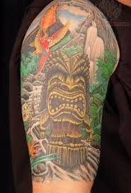 What does tiki tattoo mean? We have tiki tattoo ideas, designs, symbolism and we explain the meaning behind the tattoo. Leg Sleeve Tattoo, Tattoo Sleeve Designs, Arm Band Tattoo, Tropical Tattoo, Hawaiian Tattoo, Cover Up Tattoos, Body Art Tattoos, Unique Tattoos, Cool Tattoos