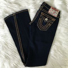 """True Religion Joey Super T Jeans EUC True Religion Joey Flare Jeans. Beautiful dark rinse with golden brown stitching. No flaws, and still have original inseam of 33.5"""". Rise is just under 7"""", 98% cotton, 2% spandex. Feel free to ask any questions! True Religion Jeans Flare & Wide Leg"""