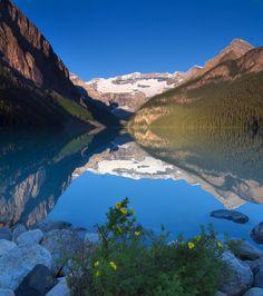 reflection on lake louise,   (banff national park, alberta, canada)