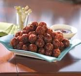 BBQ Meatballs  Frozen Meatballs marinated in BBQ sauce in a crock pot for a couple of hours