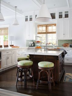wood island, white surround kitchen cabinetry