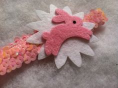 Shiny pink sequin headband with white starburst by HairFlairLady, $7.00