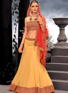 This  Beige Net Embroidered Patch Border Work Designer Lehenga Choli which will make you look striking and even more beautiful. Made of  Netn more beautiful. Made of georgette, It,s quite comfortable to wear and easy to drape as well.