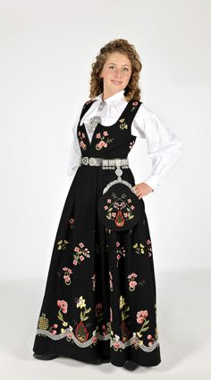 """Black """"Grafferbunad"""" with embroidered waist and skirt from Lom, Gudbrandsdalen, Oppland, Norway (I don't think the belt is originally a part of this bunad. The bunad also have a hat, but the model doesn't wear it) Folk Costume, Costumes, Evolution T Shirt, Classy Outfits, Classy Clothes, Costume Makeup, Traditional Dresses, Girl Dolls, Norway"""