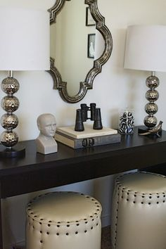 love these lamps and space saving of ottomans under the table!
