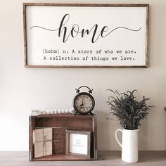 home: A story of who we are. A collection of things we love. This beautiful framed farmhouse sign will add a classic farmhouse touch to any space in your home! #ad #fixerupper #farmhouse