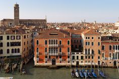 The balcony of Palazzo Alverà Altana overlooking the Grand Canal, the Church of the Frari and the fascinating city skyline.