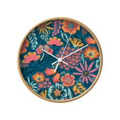 The French Fiesta Wall Clock delivers an exceptionally splendid shock of color and beautiful floral design. We can't stop staring at its explosive spray of painted flowers surrounded by a natural woode...  Find the French Fiesta Wall Clock, as seen in the Mid-Century In Bloom Collection at http://dotandbo.com/collections/mid-century-in-bloom?utm_source=pinterest&utm_medium=organic&db_sku=106091