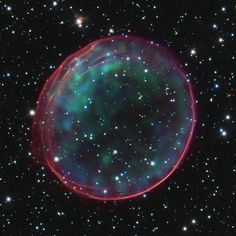 Supernova remnant 0509-67.5, located in the Large Magellanic Cloud (LMC), a small galaxy about 170,000 light-years from Earth