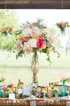 tall floral centerpiece - photo by Rebecca Ellison Photography http://ruffledblog.com/coral-and-mint-dallas-wedding