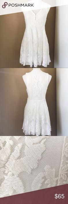 Free People Reign Over Me Dress Ivory NWT 🌬 Beautiful white lace skater dress from Free People. It has a super flattering fit and flare silhouette and is partially lined. The front has hook closure as well. Tons of great detail on this dress! This item is NWT however there's a small hole in the lace on the back (pictured). Free People Dresses Mini