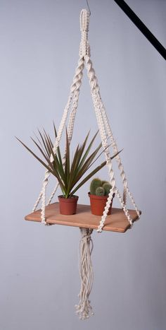 Macrame hanging table modern plant hanger, hanging shelf, 5 mm cotton Cord, boho shower gift Macrame hanging table, creamy off white 5 mm braided cotton Cord. Many knots and variations give th Hanging Table, Hanging Shelves, Diy Hanging, Hanging Plants, Plants Indoor, Outdoor Plants, Diy Projects To Make And Sell, Diy Simple, Macrame Plant Holder