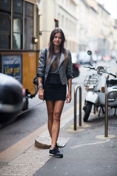 Chloé in a silver tweed motorcycle jacket, spiked bracelets and NEW BALANCE sneakers.
