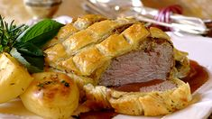 BEEF WELLINGTON - Beef Wellington is a classic dish that is much easier to make than you may think! Serve it with roast potatoes and gravy.