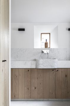 marble and wood for a contemporary bathroom