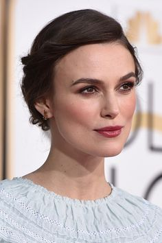 Want a timeless up-do that is veil-proof too? Keira Knightley's pretty do, complemented by berry rich lipstick, blush and eye make-up will do the trick!