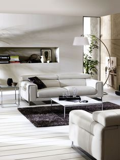The Etoile is front in centre in our Natuzzi Italia Store at Sandy's Furniture!