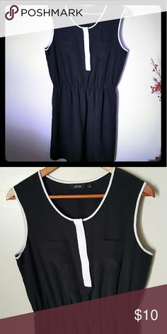 Black and white dress Black, sleeveless dress with white accents. 2 little pockets on the front, elastic waist. Hits just above the knee. Very flattering! Apt. 9 Dresses Mini
