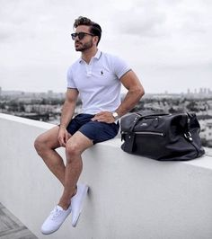 - with a summer outfit idea with navy shorts no show socks white canvas sneakers white polo shirt black leather duffle bag Short Outfits, Casual Outfits, Casual Shorts Outfit, Casual Clothes, Casual Dresses, Stylish Men, Men Casual, Casual Styles, Look Man