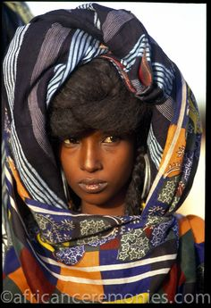 A Wodaabe woman veiled in colorful scarves by Angela Fisher & Carol Beckwith