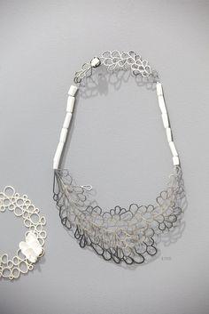 "Necklace   Pauline Edie. ""Origin 2011"".  Porcelain, silver.    Photo credit © Sophie Mutevelian"