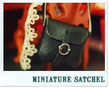 Detailed instructions to make a satchel or leather purse from : faux leather, jump ring, silver headpin, pliers, matching thread, needle. | Source: Bored and Crafty