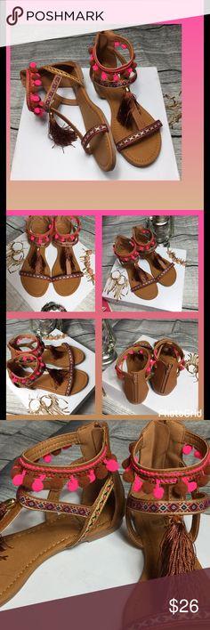 Just in! Boho Pom Pom tassel sandals NIB Boho Pom Pom tassel sandals NIB. Cute Pom poems, vibrant colors. Great for festival wear. Zips in the back. Shoes Sandals