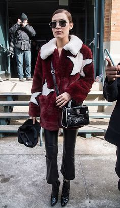 Bella Hadid street style in star print faux fur coat, cropped jeans and mini bag