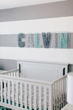 DIY Name above Crib using Nails and Yarn - such a cute touch in a modern nursery!