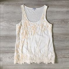 """Cream Lace Tank Gorgeous tank top with sequins, lace and mesh on the front (fully lined) and a sheer back. Soft and flowy! Beautiful cream and ivory color with pale pink sequins. Flat measurements: 16.5"""" bust, 8.5"""" arm opening, 25"""" long, 19"""" across bottom hem. [Note: This is a duplicate listing to show more photos of this top. I only have one of this top.] Express Tops Tank Tops"""