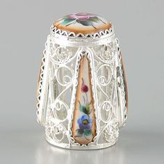 """Russian Filigree Enamel Finift Thimble. This collectible Rostov finift thimble is adorned by intriguing filigree lace features a wonderful enameled design with vibrant colors. The art of Russian Enamel painting, named """"Rostov Finift"""", originated and flourished in Rostov since the 1700s. Today, artists in the Rostov Finift factory in Russia use the heritage of ancient masters to create such delightful masterpieces."""