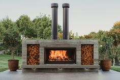 Outdoor Fireplace Patio, Outdoor Fireplaces, Oven Inspiration, Fireplace Gallery, Stainless Steel Paint, Modern Lake House, Chimney Cap, Wood Storage Box, Custom Fireplace