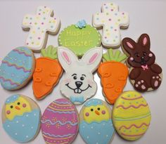 Big Bunny Face, chick broken eggs, full body rabbit, carrot, decorated eggs decorated sugar cookies by I Am the Cookie Lady