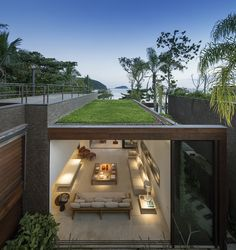 Built by Studio Arthur Casas in , Brazil with date 2012. Images by FG+SG | Fernando Guerra. Four houses in front of Baleia Beach, on the northern coast of São Paulo. As a weekend house all the ground floor spa...