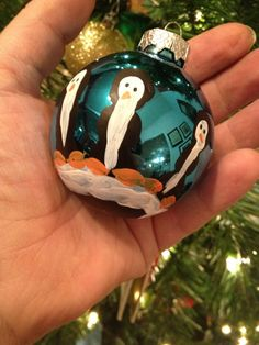 I made these adorable penguin ornaments with my two year old last night. They turned out great. I used black acrylic paint which I poured about a teaspoon of onto a styrofoam plate. I stuck his han...