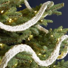 Shop Cozy Knit Ivory Garland. Wound around a banister or draped on the mantel this hand knit ivory garland creates a cozy ambiance with its chunky weave of cuddly wool-blend yarn.
