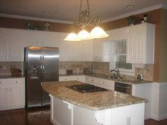 Traditional kitchen with white cabinets and Gallo Napoli granite.